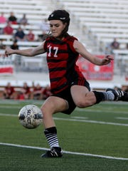 Wichita Falls High School's Alyssa Hollis passes the ball Friday, March 31, 2017, in Mineral Wells for the Region I-5A area playoff against Grapevine. The Mustangs defeated the Coyotes on penalty kicks 7-6.