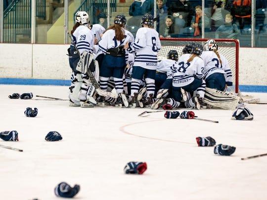 Middlebury College hockey team celebrates Sunday's