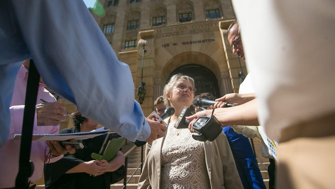 State Superintendent Diane Douglas leaves the Maricopa County Court House in Phoenix on Friday, June 26, 2015. Douglas has tussled with the Arizona State Board of Education and Gov. Doug Ducey over who supervises board staff.