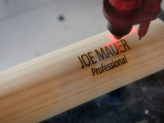 A Xylo Bat is engraved with the name of Joe Mauer,