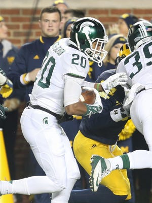 Michigan State Spartans defensive back Jalen Watts-Jackson runs back a muffed punt by the Michigan Wolverines for the winning touchdown Saturday, Oct. 17, 2015, in Ann Arbor.