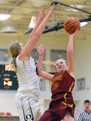 Galesburg-Augusta's Samantha Verburg drives the basket late in the first period Tuesday night.