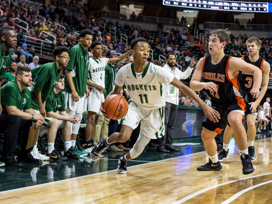 New Haven's Tavares Oliver works the ball down court