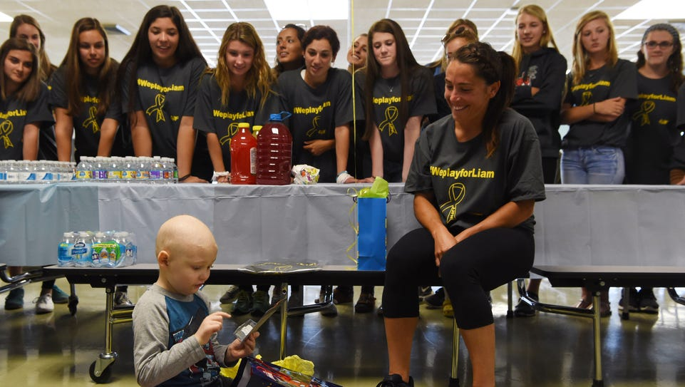 Liam Craane, 5, left, who is battling pediatric cancer,