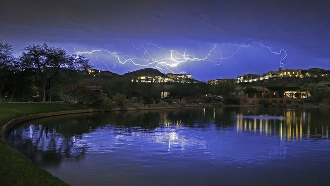 Intracloud Lightning streaks across the night sky as seen from Ahwatukee on Oct. 29, 2015 in Phoenix.