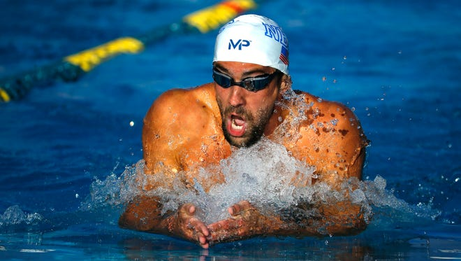 Michael Phelps on his way to winning the Men's 200 Meter IM Final with a time of 1:57.90 during the Arena Pro Swim Series Saturday, April 16, 2016 in Mesa, Ariz.
