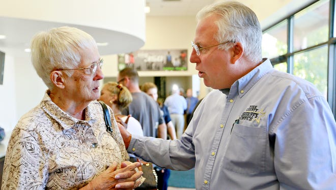 Sue Doering, 80, of York City, is reassured by York County Sheriff Richard Keuerleber while she waits her turn to resolve three parking-ticket warrants during Operation Safe Surrender at Stillmeadow Church of the Nazarene's York City campus on Thursday, Aug. 24, 2017. Operation Safe Surrender gives people with outstanding warrants the opportunity to resolve their issues in a neutral, faith-based setting. (Dawn J. Sagert photo)