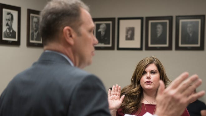 Mandy Kenz, along with 16 others, was sworn in Friday afternoon by Judge Jeff Benson as a CASA juvenile advocate for the Ross County Juvenile Court system.