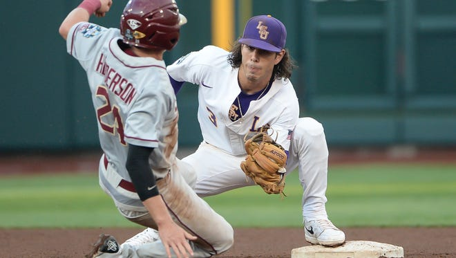 Jun 17, 2017; Omaha, NE, USA; LSU Tigers infielder Kramer Robertson (3) tags out Florida State Seminoles infielder Matt Henderson (24) for the last out in the fourth inning at TD Ameritrade Park Omaha. Mandatory Credit: Steven Branscombe-USA TODAY Sports
