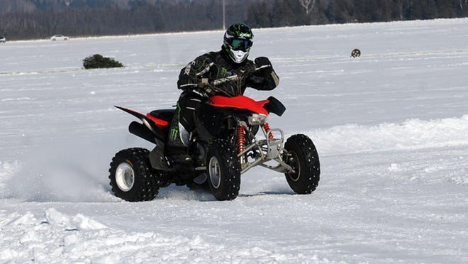 Cody Hoffman negotiates a frozen Kangaroo Lake on his ATV. The lake is the site of radar runs and the Door County Pond Hockey Tournament on Feb. 7 for the Baileys Harbor Winter Carnival.