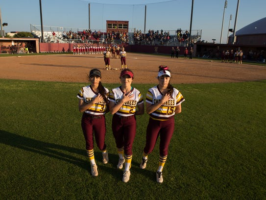 Tuloso-Midway's out fielders Evonne Valdez, Brisa Perez,