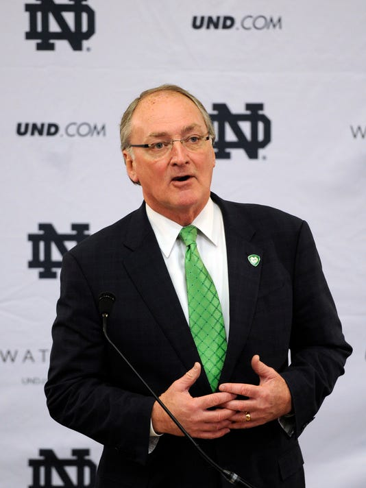 ADVANCE FOR USE MONDAY, SEPT. 5 - In this Jan. 21, 2014, file photo,  Jack Swarbrick, Notre Dame Vice President and Director of Athletics, speaks in South Bend, Ind. Swarbrick has overseen a lot of changes in his eight years as Notre Dame athletic director. (AP Photo/Joe Raymond)