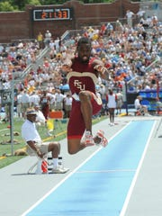 Florida State's Rayon Taylor jumps during the triple-jump