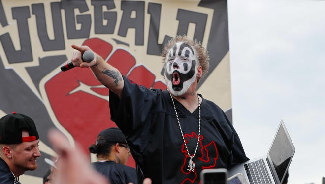 Violent J, a member of the rap group Insane Clown Posse, yells on stage before speaking to juggalos in front of the Lincoln Memorial in Washington.