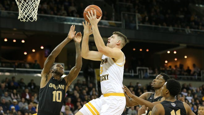 Northern Kentucky Norse forward Drew McDonald (34) goes up for a shot as Oakland Golden Grizzlies forward Isaiah Brock (10) defends in the first half during the NCAA college basketball game between Oakland Golden Grizzlies and the Northern Kentucky Norse, Friday, Jan. 26, 2018, at BB&T Arena in Highland Heights, Kentucky.