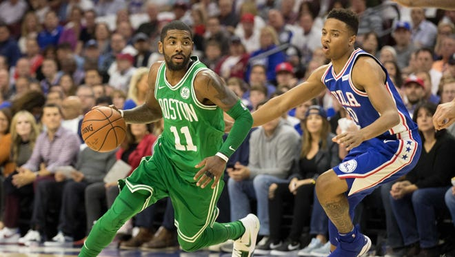 Boston Celtics guard Kyrie Irving (11) dribbles past Philadelphia 76ers guard Markelle Fultz (20) during the first quarter at Wells Fargo Center.