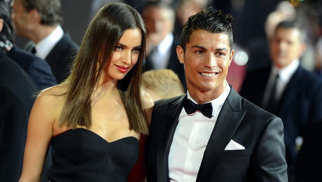 Portugal's Cristiano Ronaldo, right, as he  arrives with his girlfriend Irina Shayk on the red carpet prior to the FIFA Ballon d'Or Gala 2013 held at the Kongresshaus in Zurich, Switzerland.