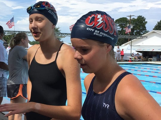 COSST's Brooke Fegley and Abigail Jackson talk with coach Butch Jordan Sunday afternoon.