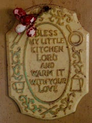 Sammy Charchio home located on Wells Island Road was destroyed by the flood, this little kitchen prayer plaque still hangs in the kitchen.