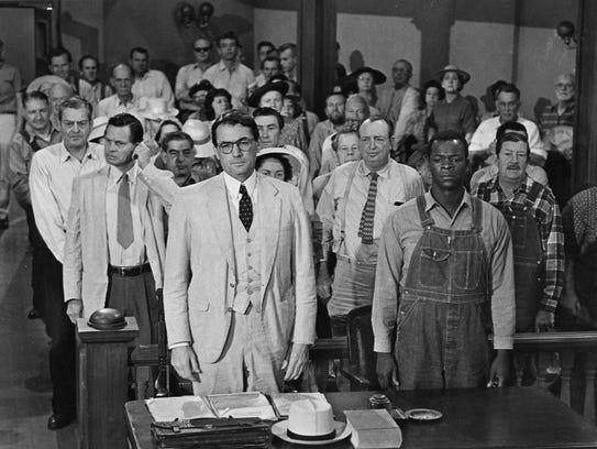 Gregory Peck, front left, stars as Atticus Finch and