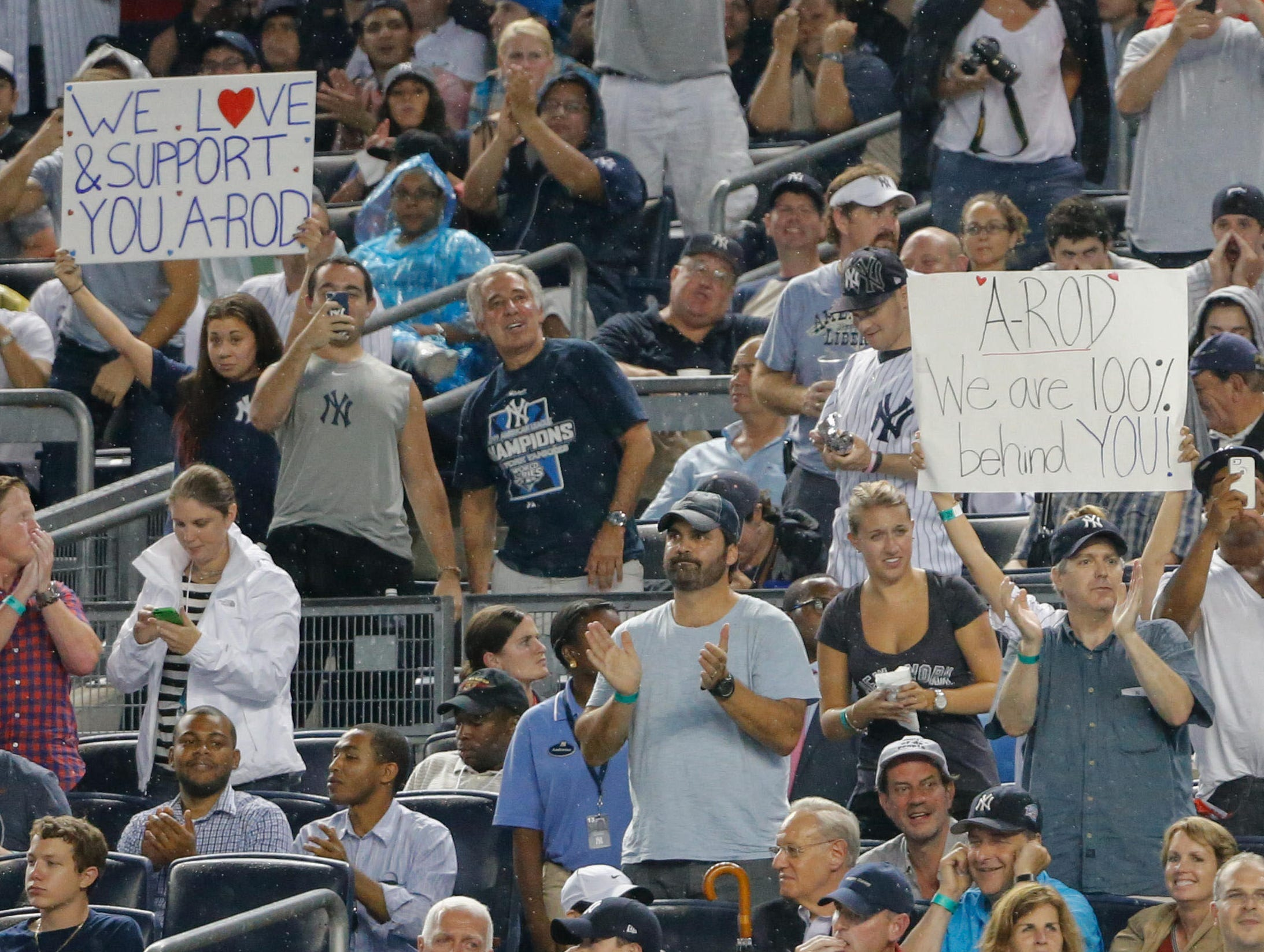 Fans display signs of support for New York Yankees third baseman Alex Rodriguez during the game against the Detroit Tigers at Yankee Stadium.