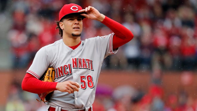 Cincinnati Reds starting pitcher Luis Castillo pauses during the first inning of a baseball game against the St. Louis Cardinals, Sunday, April 22, 2018, in St. Louis.