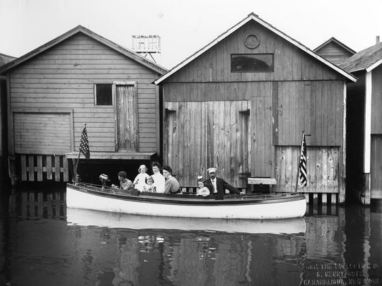 "Setting off on the lake for a cruise, circa 1900, following construction of the City Pier ""finger piers"" and the relocation of the boathouses."