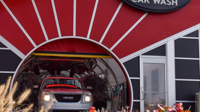 A car drives through a Quality Car Wash location. The company first launched in 1969 and recently celebrated its 50th year in business.