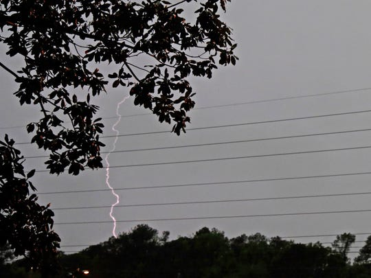 Lightning splits the sky as severe thunderstorms roll through Tallahassee Monday evening.