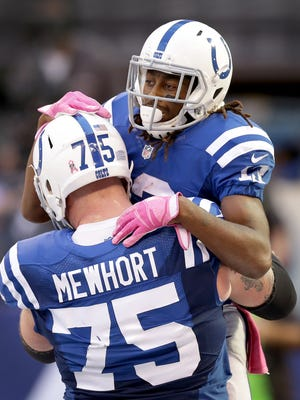 Indianapolis Colts wide receiver T.Y. Hilton (13) celebrates his touchdown with Jack Mewhort (75) in the 4th of their game. The Indianapolis Colts host the Chicago Bears in their NFL football game Sunday, October 9, 2016, afternoon at Lucas Oil Stadium.