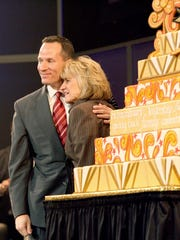 Christopher Ilitch hugs his mom Marian Ilitch during  Little Caesars Pizza 50th anniversary celebration at the Fox Theatre in Detroit, May 8, 2009.