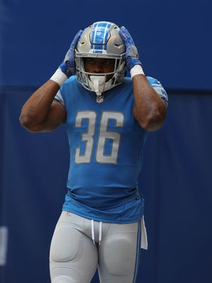 Detroit Lions' Dwayne Washington warms up before action against the Indianapolis Colts Sunday, August 13, 2017 at Lucas Oil Stadium in Indianapolis, Ind.