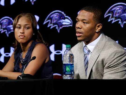 """FILE - In this May 23, 2014, file photo, Baltimore Ravens running back Ray Rice, right, speaks alongside his wife, Janay, during a news conference, Friday, May 23, in Owings Mills, Md. Rice's two-game suspension for domestic violence begins Saturday, a punishment handed down after grainy video showed him dragging his then-fiancee off a casino elevator unconscious Feb. 15. He has not divulged what happened in the elevator except to call his actions """"totally inexcusable'' at a news conference after his suspension was announced. His assault charges could be expunged once he completes a diversion program. So the NFL gave him the only punishment he likely faces in a suspension and a fine that totals more than $500,000. (AP Photo/Patrick Semansky, File)"""