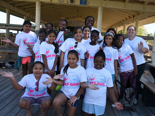 The GEMS, Girls Envisioning More Success, from Golden Gate Elementary School, came to Lowdermilk Park to help with Bay Days.  About 1,500 volunteers hit Collier County beaches - and canals, shorelines and related areas - on Saturday, April 8, for Bay Days, a coasal cleanup that it part of a national effort.