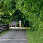 Walkers enjoy the William R. Steinhaus Dutchess Rail Trail near Morgan Lake in the Town of Poughkeepsie.