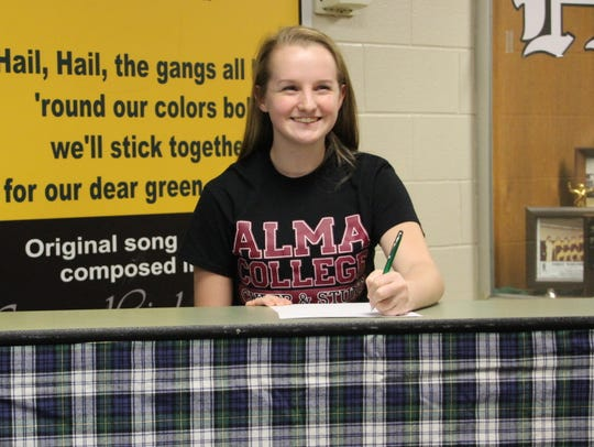 Bailey Barnes of Howell will be a cheerleader at Alma