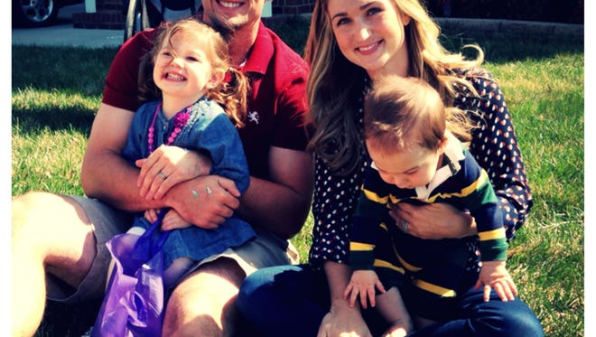 Adam Podlesh holds his daughter, Addison, 3, and his wife, Miranda, holds their son, Carter (16 months).