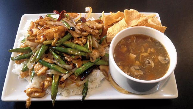 The Spicy Asparagus Chicken Combo comes with either soup or a cabbage salad at CoLi Wok and Grille.