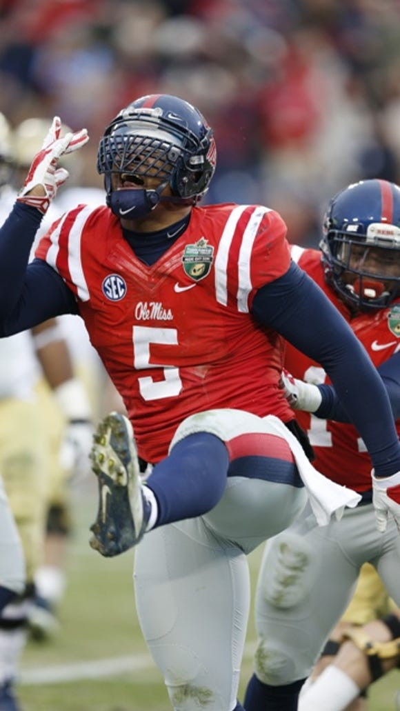 NASHVILLE, TN - DECEMBER 30: Robert Nkemdiche #5 of the Ole Miss Rebels celebrates after a tackle behind the line of scrimmage in the first half against the Georgia Tech Yellow Jackets during the Franklin American Mortgage Music City Bowl at LP Field on December 30, 2013 in Nashville, Tennessee. (Photo by Joe Robbins/Getty Images)