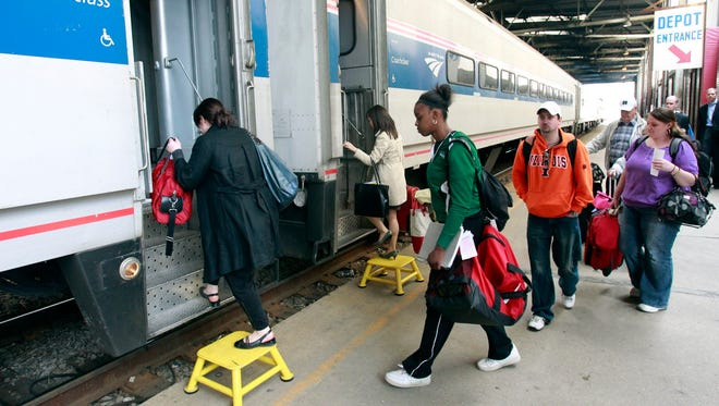 Passengers board a Chicago-bound Amtrak train. With Foxconn Technology Group's plans for a major manufacturing campus in Mount Pleasant, the train could play a role in taking people to work.