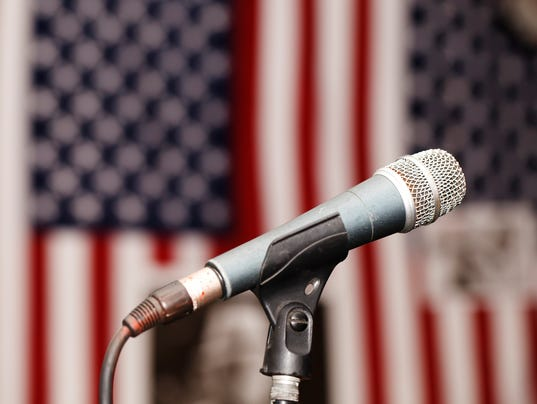 Old vintage microphone on the background of the American flag