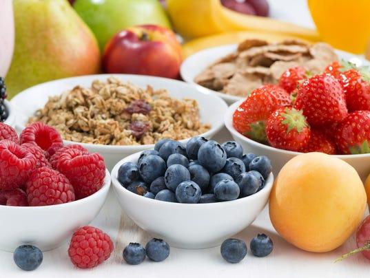 fresh berries, fruit and muesli for breakfast, close-up