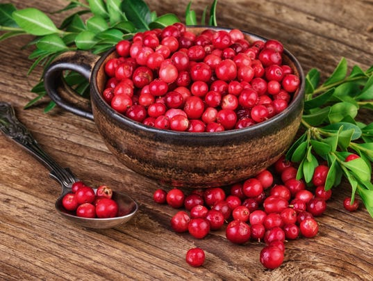 Cranberry organic berries over wood