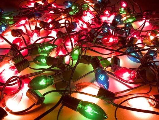 Close-up of lit up Christmas lights