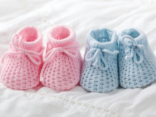 Close-up of pink and blue crocheted baby shoes