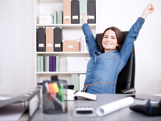 Office Woman Sitting on Chair Stretching her Arms