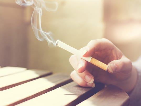 Woman smoker smoking a filter tip