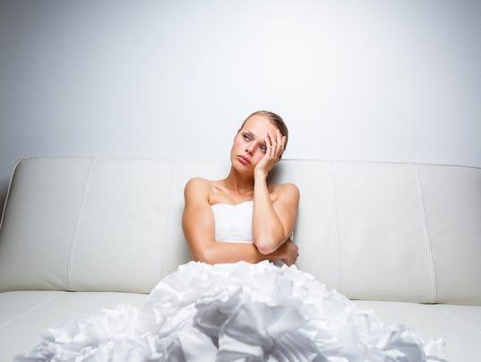 Sad bride wearing a wedding dress