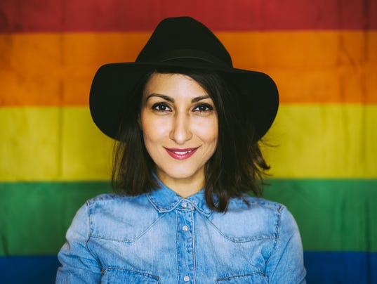 Stylish Gay Girl Posing in front of Gay Flag