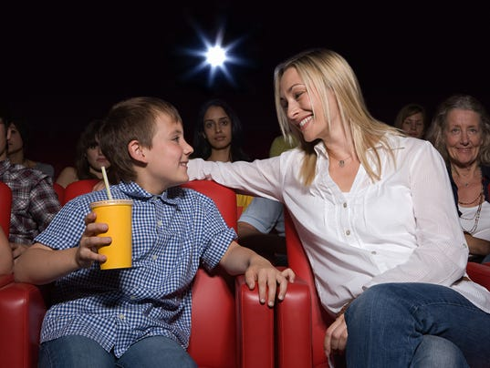 Mother and son enjoying a movie